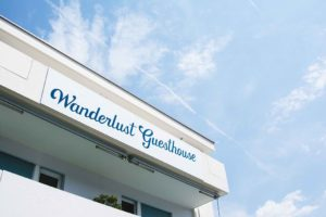 Wanderlust Guesthouse Logo